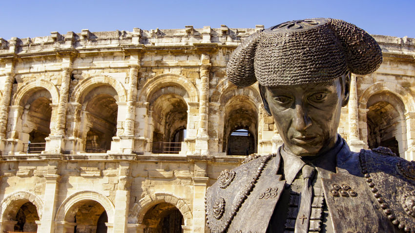 Ancient Ancient Civilization Architecture Building Exterior Built Structure Bull Fighter Bull Ring Day History Human Representation Nimes France No People Nîmes Outdoors Sculpture Statue Travel Destinations Neighborhood Map An Eye For Travel