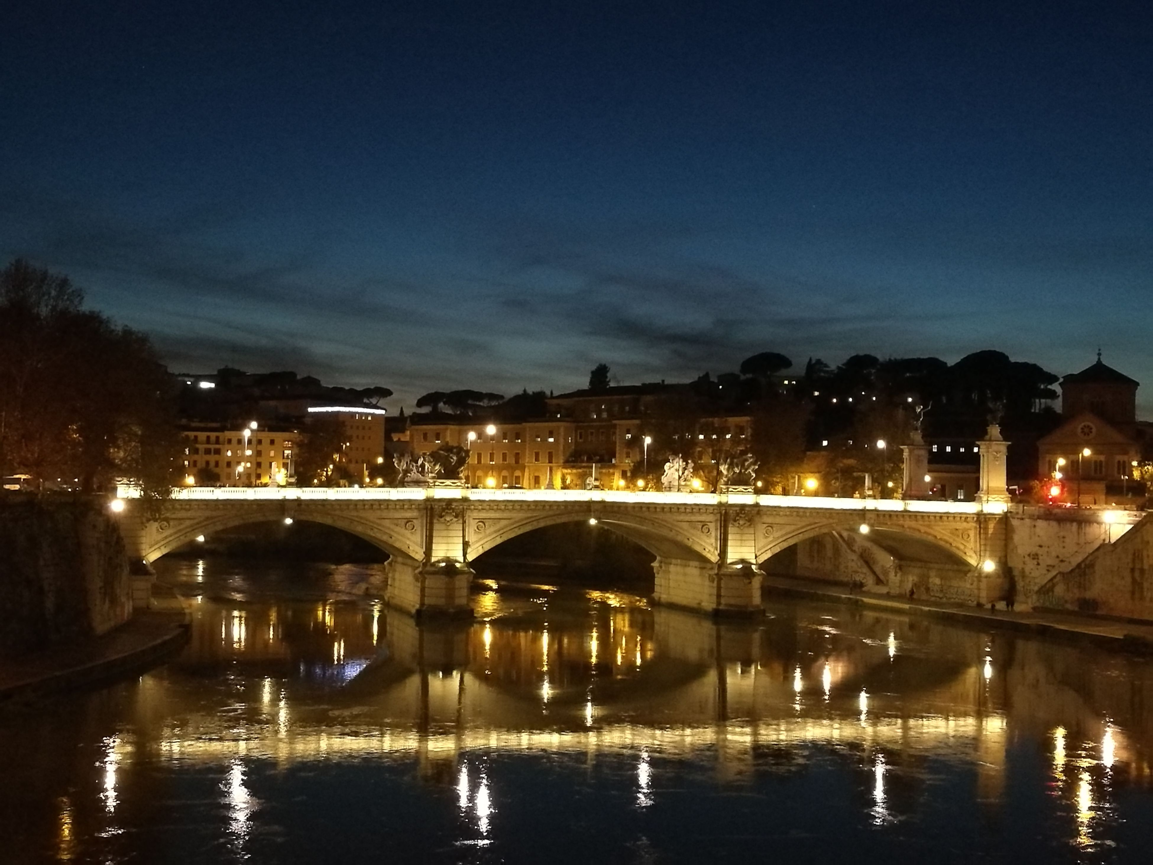 bridge - man made structure, architecture, connection, built structure, reflection, illuminated, transportation, water, night, city, river, building exterior, travel destinations, outdoors, sky, no people, public transportation, tree, star - space