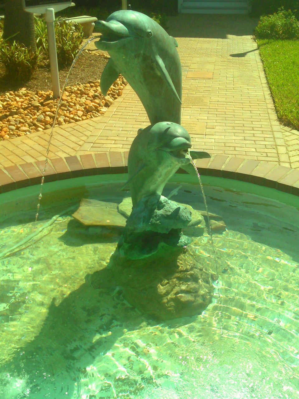 statue, sculpture, art and craft, water, human representation, day, green color, no people, outdoors, growth, nature, close-up