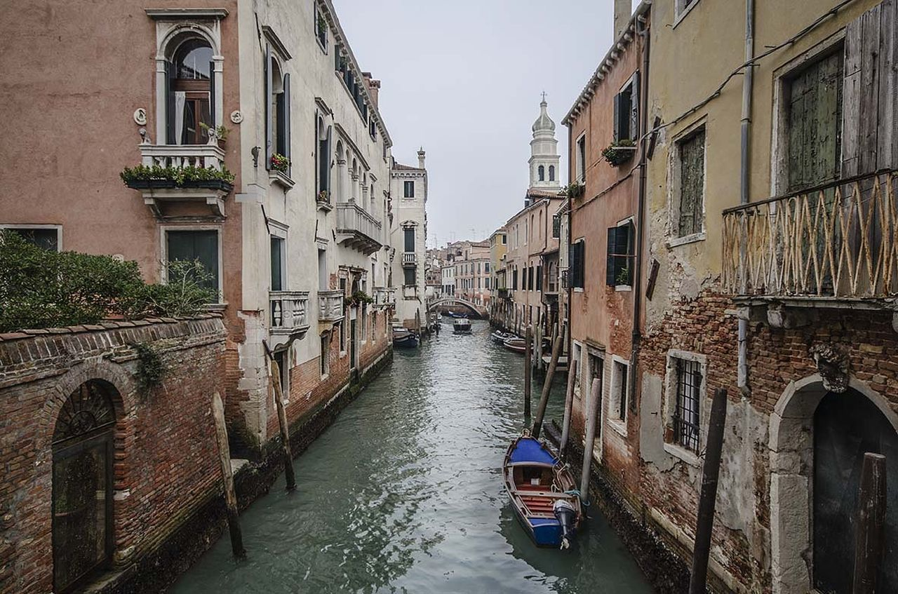 building exterior, architecture, built structure, canal, day, transportation, nautical vessel, residential building, water, outdoors, gondola, no people, sky, travel destinations, gondola - traditional boat, city