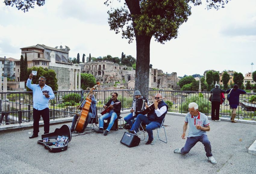 Lovely to watch a man dancing to live music. I hope this picture captivates the joy and vibrance of the city!The Street Photographer - 2017 EyeEm Awards Musical Instrument Musician Outdoors City Only Men Arts Culture And Entertainment Ancient Ruins Busking Live Music Live Music Photography Dancing Dance Free Spirit Expression ExpressYourself Rome Rome, Italy Italia Tourism Tourist Cello Classical Guitar Neighborhood Map The Photojournalist - 2017 EyeEm Awards Visual Feast