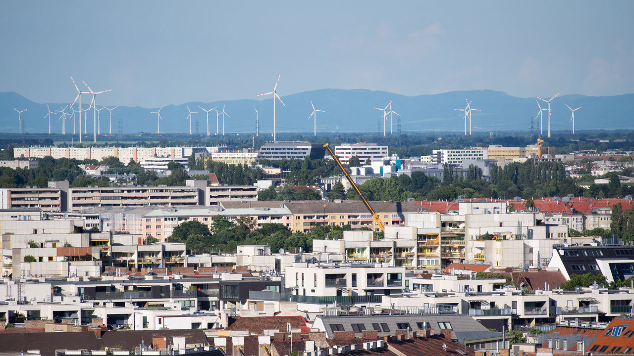 Wind turbines in Vienna, Austria Alternative Energy Architecture Built Structure City Cityscape Day Fuel And Power Generation Mountain No People Outdoors Renewable Energy Sky Wind Power Wind Turbine Windmill