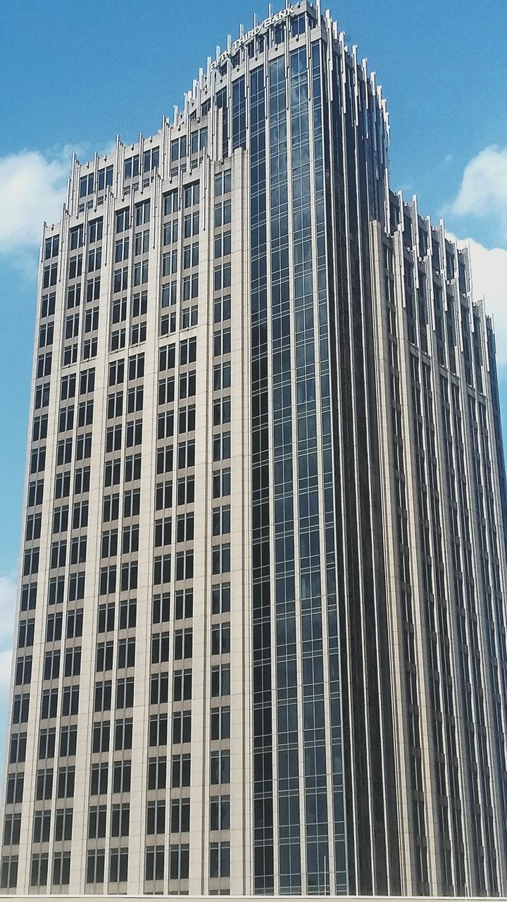 low angle view, architecture, building exterior, sky, built structure, outdoors, day, modern, skyscraper, no people, city
