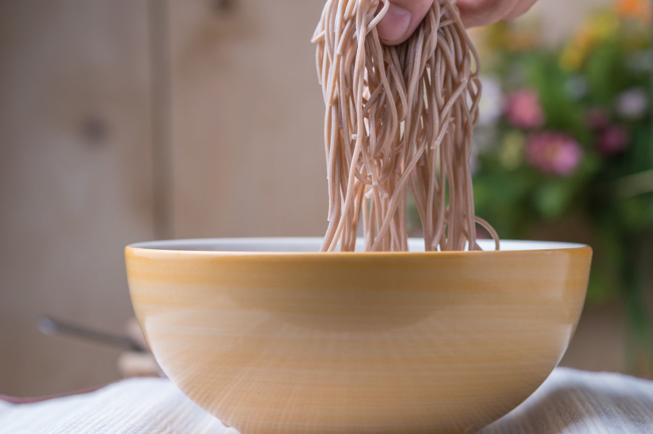 Japanese Food Noodles Soba Noodles Bowl Buckwheat Noodles Close-up Day Focus On Foreground Food Freshness Human Hand Indoors  Midsection One Person Preparing Food Real People Soba