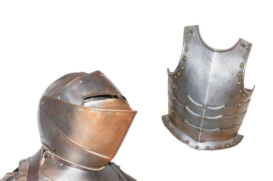 An antique European armor with helmet and breastplate isolated against white background. Armed Forces Army Close-up Day Helmet Metal Military Military Uniform No People Shield Studio Shot Suit Of Armor War Weapon White Background