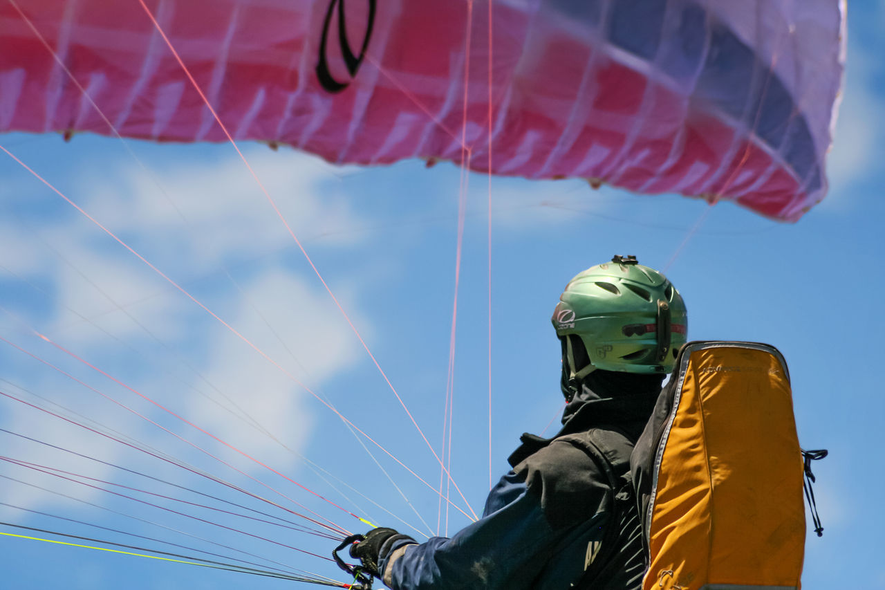 Pre flight check on Woodrat Mountain. Play EyeEm Best Shots People Flying Equipment Paragliding Recreation  Flight Recreational Pursuit Popular Photos Capture The Moment Anticipation Parasailing EyeEm Gallery Hopeful Dreaming Almost Enjoying Life Gliding One Man Only Popular Colorful Competition Sports Beginnings