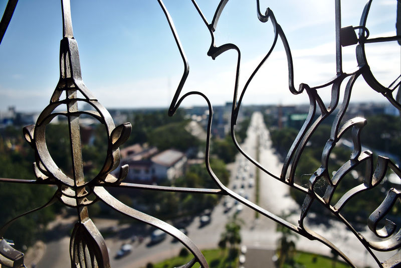 Buddha Image Cityscape Patuxai Travel Photography Vientiane Vientiane, Laos Close-up Focus On Foreground Intricate Laos Laos Travel Metal Metalwork No People Sky Tower Travel Destinations World Travel