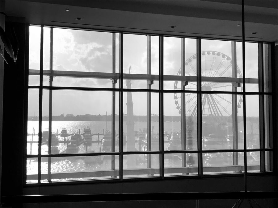 Structure Marina Curtain Wall Ferris Wheel Scenic View Transparent Looking Through Window National Harbor, MD USA Potomac River Black And White Friday