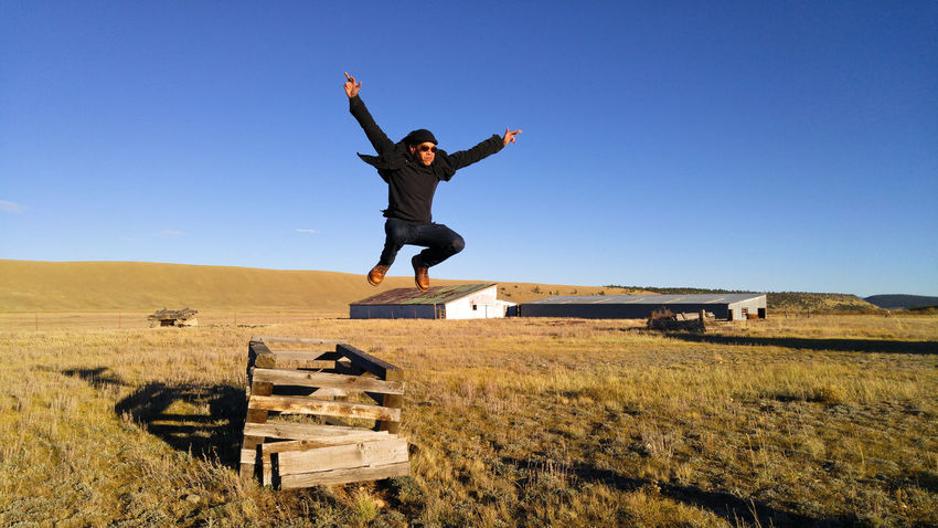 Altitude Big Sky Colorado EyeEmNewHere Jump Man Ranch Rural Action Airborne Arms Raised Clear Sky Energy Jumper Jumping Leap Midair Outdoors Rurex Valley