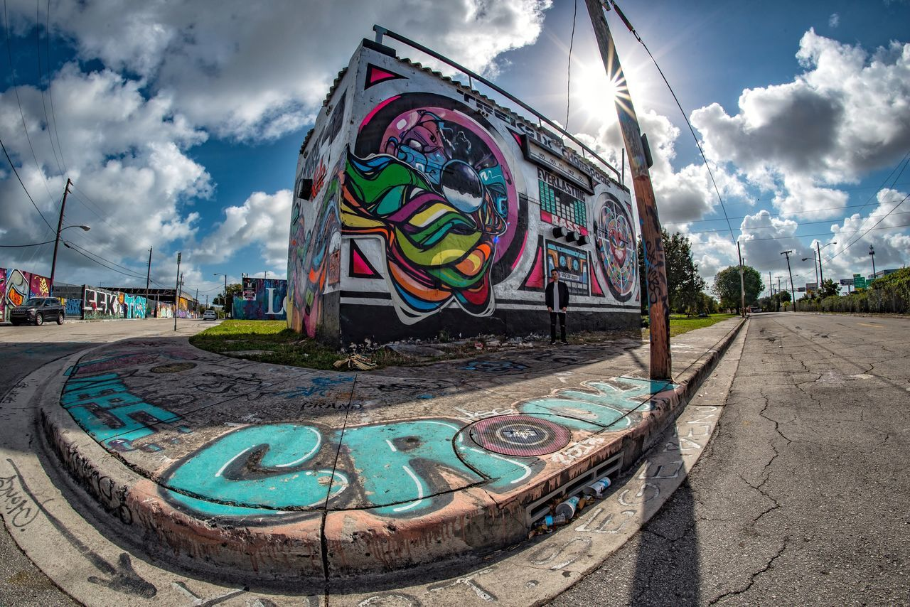 Finding New Frontiers Cloud - Sky Sky Multi Colored Outdoors Day No People Flag Graffiti Art ArtWork Urban Landscape Urbanphotography Miami Street Streetphotography Street Photography Eye4photography  EyeEm Best Shots Portrait Photography Creativity Art And Craft