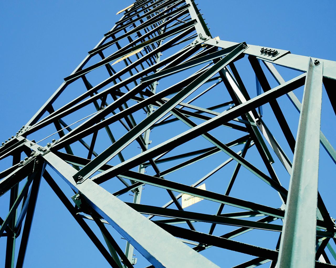 Pylon structure. Low Angle View Architecture Built Structure Clear Sky Sky Day Electricity Pylon Outdoors Green Color Environment Umwelt Environmental Safety Metal Volt Cable Watt Tower Technology Close-up Background Bolts