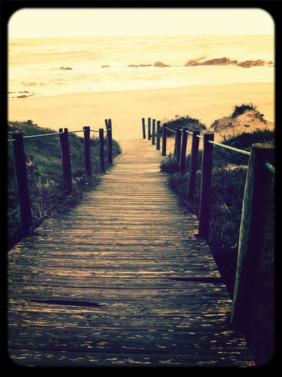 sea, pier, wood - material, beach, sunset, horizon over water, wooden post, outdoors, nature, water, scenics, no people, day, sky, wood paneling, grass, beauty in nature