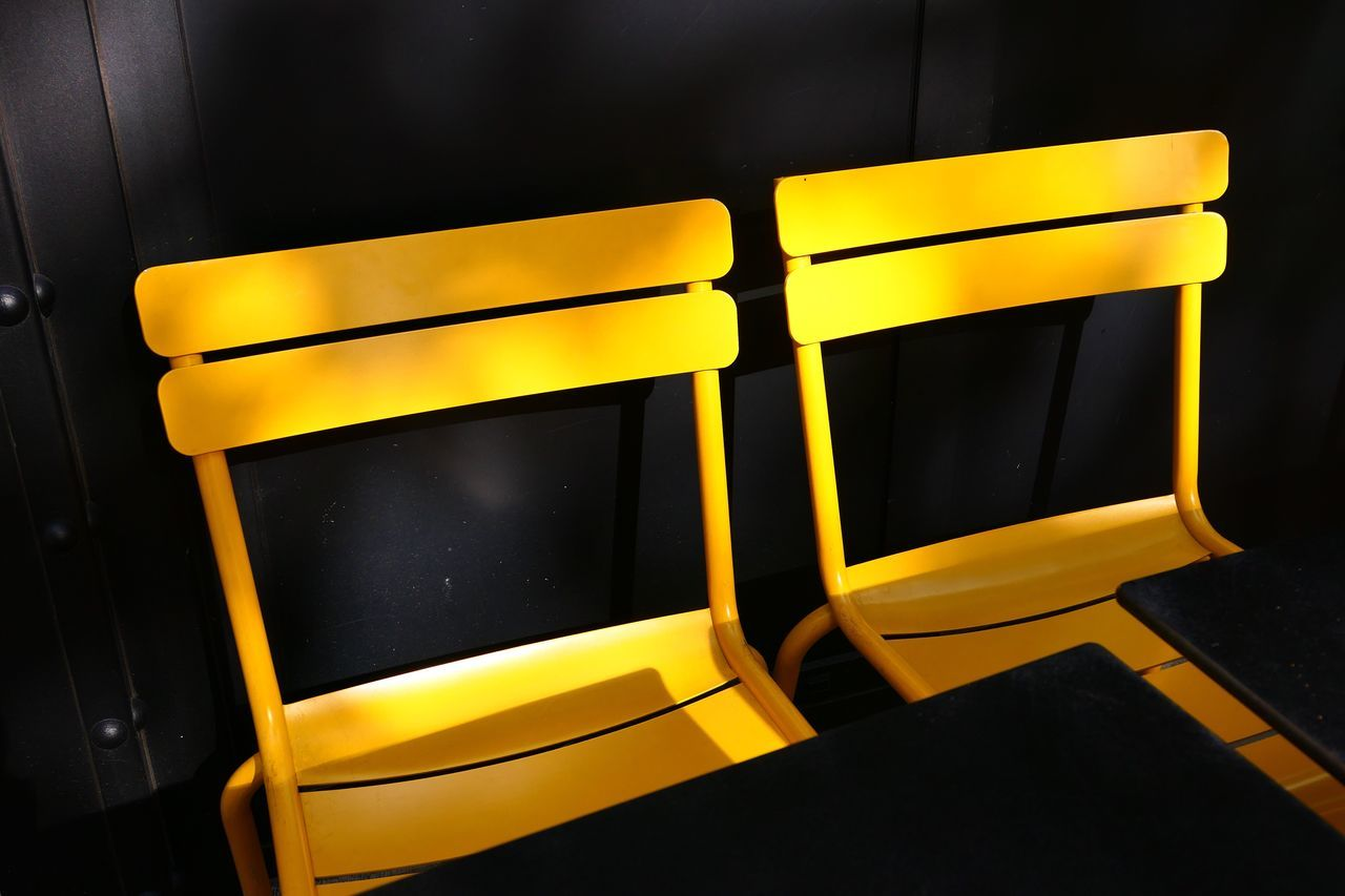 yellow, no people, close-up, indoors, black background, day