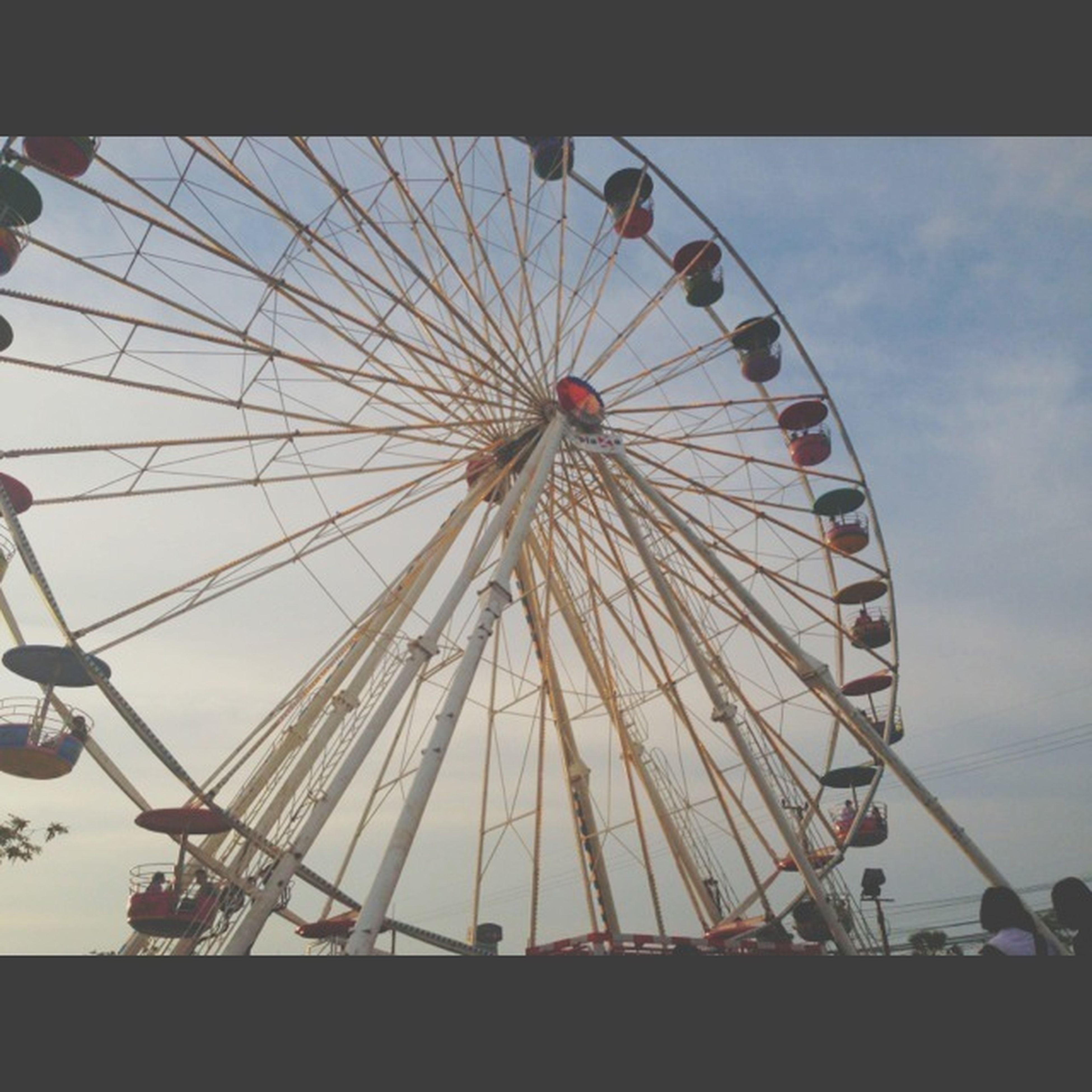 ferris wheel, amusement park, amusement park ride, low angle view, arts culture and entertainment, sky, built structure, architecture, cloud - sky, metal, outdoors, day, no people, cloud, large, cloudy, fun, big wheel, silhouette, circle