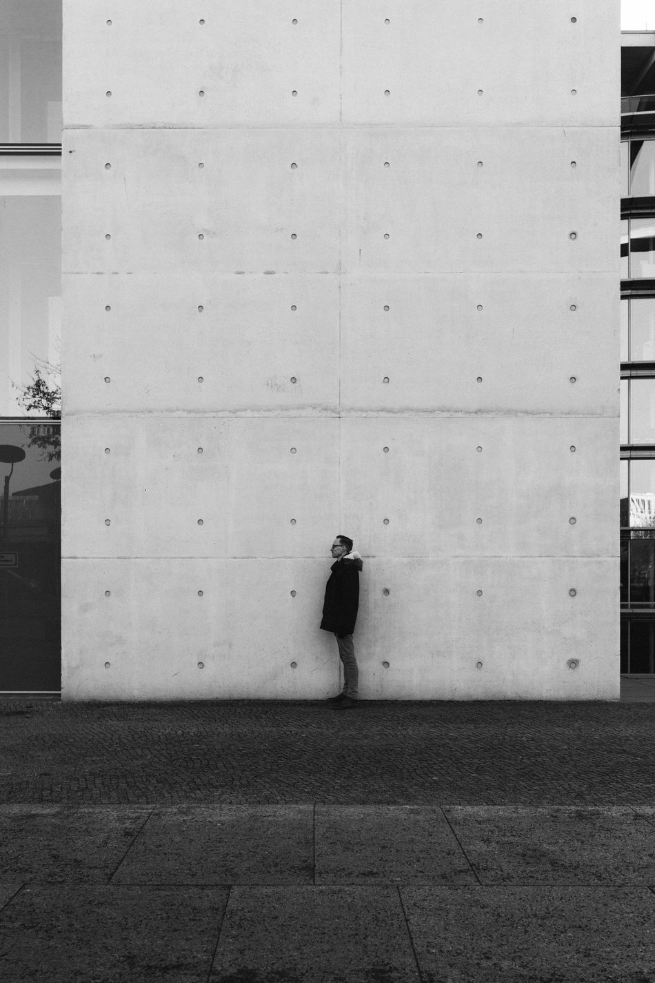 Man standing in front of huge concrete wall Adult Architecture Architecture Building Exterior Built Structure City Comparison Concrete Day Full Length Human Man Men One Person Outdoors People Real People Scale  Size Small People Standing Welcome To Black