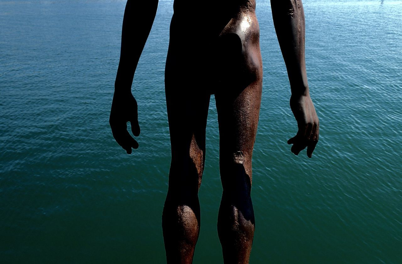 low section, water, human leg, sea, barefoot, real people, men, day, outdoors, one person, nature, beach, close-up, people