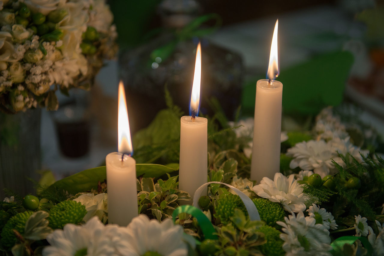 three candles on flowers decor Burning Candle Candle Light Candles Light Celebration Close-up Dark Background Day Decor Decoration Event Fire - Natural Phenomenon Flame Glowing Heat - Temperature Illuminated Indoors  Mourning No People Spirituality Table Three Candles Wedding White Flowers