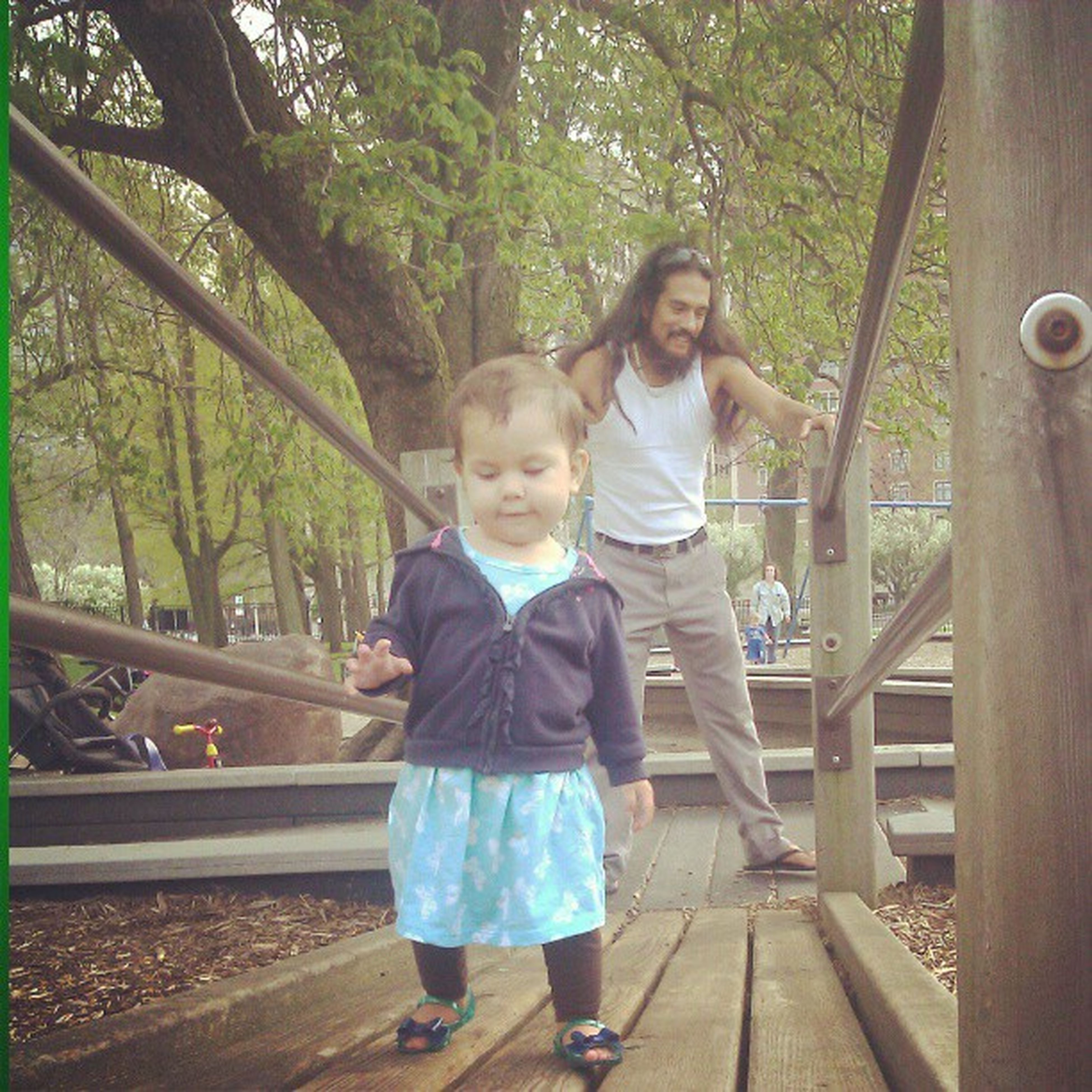 person, casual clothing, lifestyles, childhood, tree, full length, elementary age, leisure activity, boys, girls, wood - material, innocence, smiling, railing, looking at camera, front view, standing, park - man made space