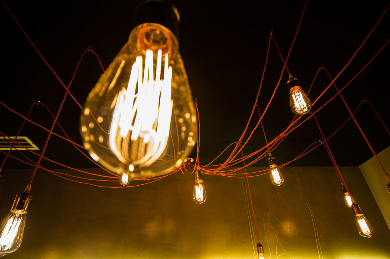 illuminated, lighting equipment, electricity, night, light bulb, glowing, no people, hanging, low angle view, gold colored, filament, studio shot, close-up, black background, technology, outdoors, sky