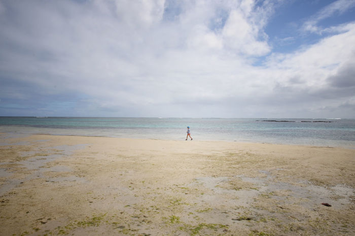 kid walking on the empty beach Beach Beauty In Nature Cloud - Sky Day Horizon Over Water Leisure Activity Lifestyles Mauritius Mauritius Island  Men Nature One Person Outdoors People Real People Sand Scenics Sea Shore Sky Tranquil Scene Tranquility Water