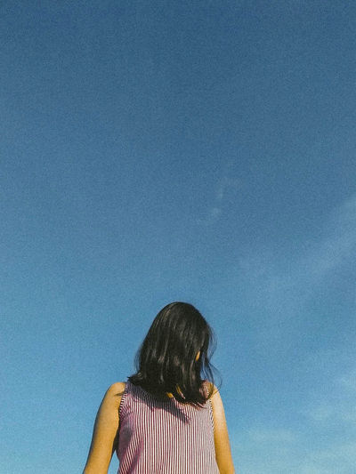 Love Blue Day Headshot Leisure Activity Lifestyles Low Angle View One Person Outdoors People Real People Rear View Sad Sky Vintage Women