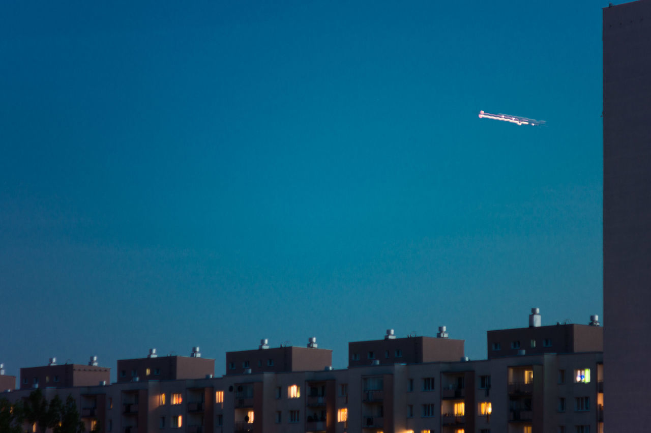 Day 84. As I was trying to capture a departing plane earlier when there was no light I startet to compensate with the exposure time which gave this effect. I thin we have our wedding photographer. 365 365 Day Challenge 365project Airplane Block Of Flats Blue City Falling Star Flying In Motion M42 No People Outdoors Roof Rooftop Rooftops Sky UFO Warsaw