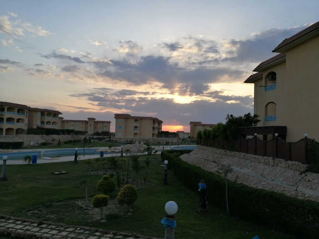 built structure, architecture, building exterior, sky, cloud - sky, house, outdoors, sunset, no people, residential building, grass, day, nature