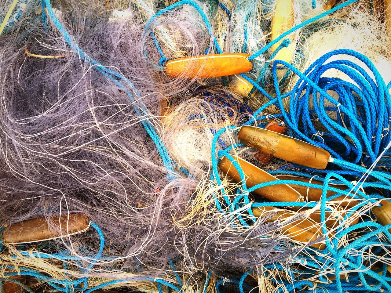 Directly Above Shot Of Fishing Net At Harbor