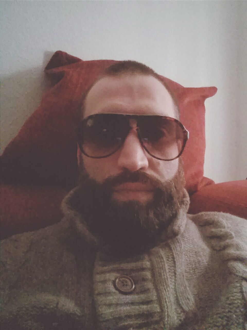 sunglasses, portrait, looking at camera, young adult, front view, home interior, one person, young men, lifestyles, beard, real people, indoors, close-up, day