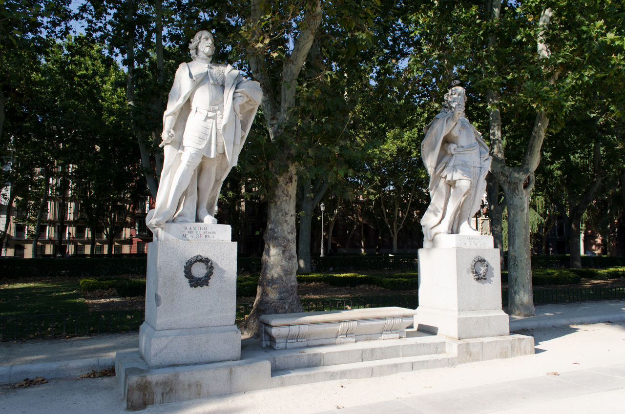 statue, tree, sculpture, human representation, art and craft, male likeness, female likeness, cemetery, memorial, marble, no people, day, outdoors