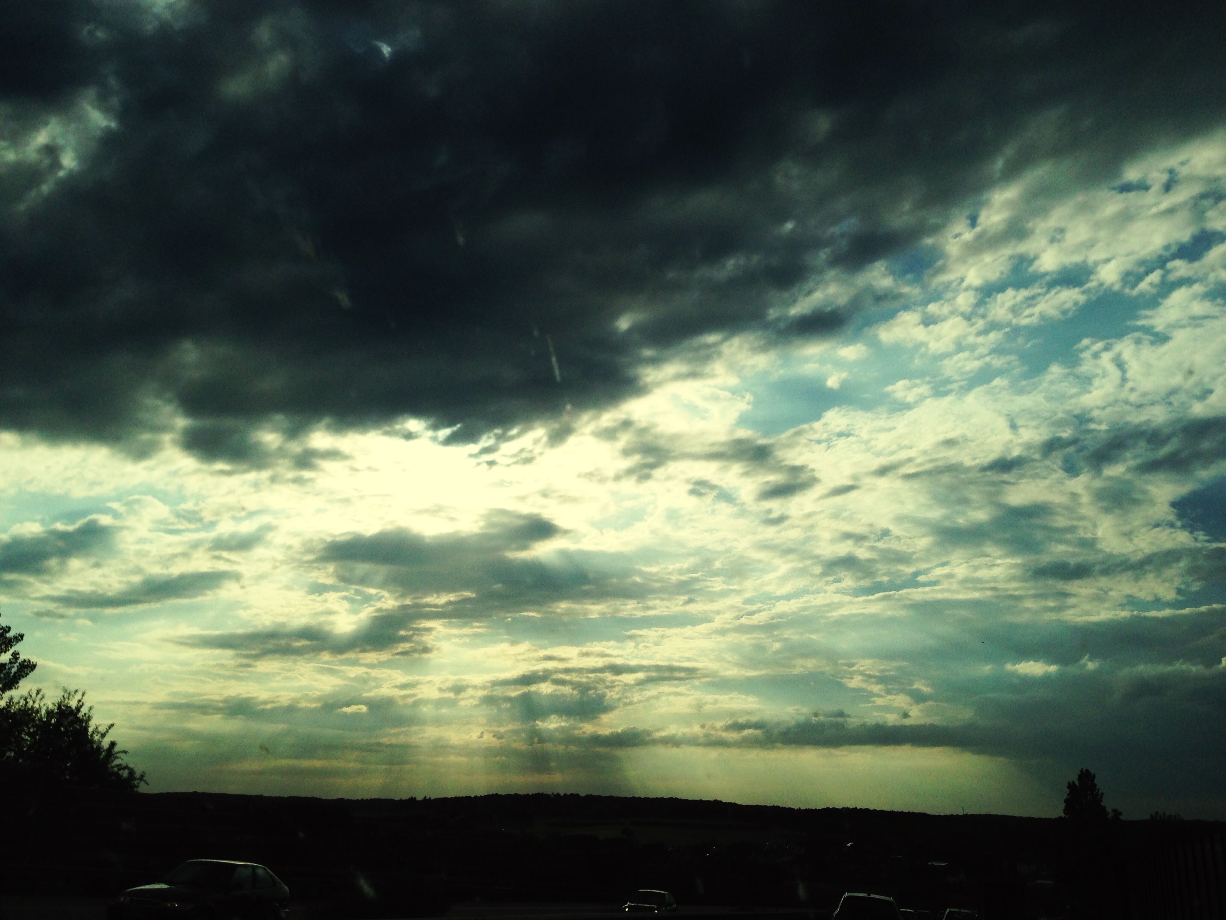 sky, cloud - sky, cloudy, silhouette, weather, overcast, sunset, beauty in nature, storm cloud, dramatic sky, scenics, cloud, tranquility, low angle view, tranquil scene, nature, cloudscape, dusk, tree, atmospheric mood