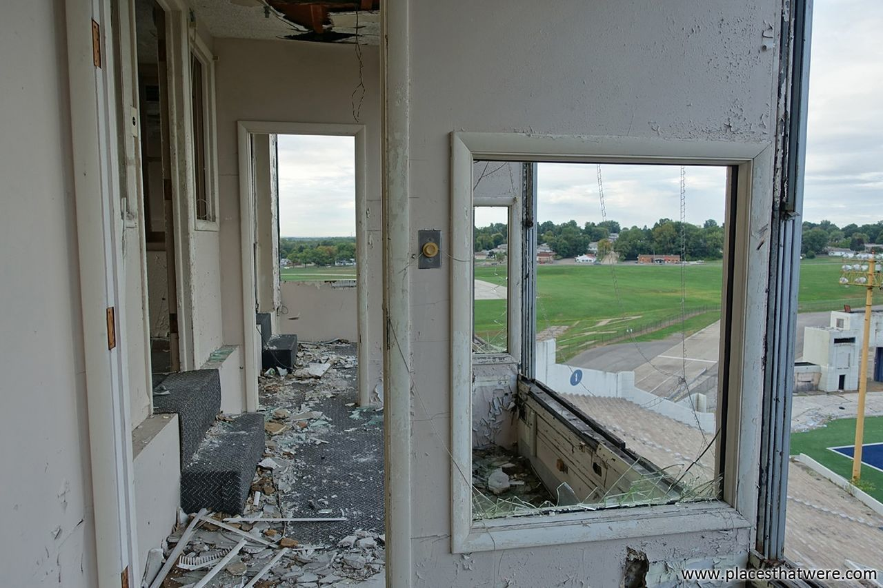 Through the press box. More here: http://www.placesthatwere.com/2017/09/abandoned-rubber-bowl-stadium-akron.html Abandoned Buildings Sport Abandoned Building Football Ruins Creepy Abandoned Urban Exploration Eerie Abandoned & Derelict Urban Decay Urbex Doorway Doorways Window Architecture Akron Zips Track And Field Stadium Akron Ohio Sports Track Football Stadium Rust Belt Abandoned Places Stadium