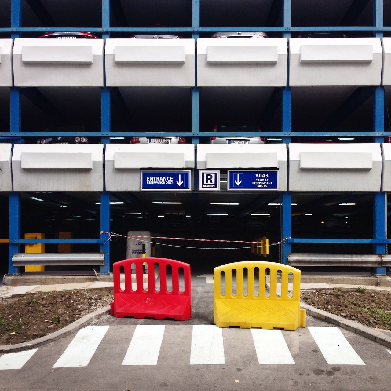 Abstract Architecture Belgrade Colour Communication Crossing Crossroads Crosswalk Day Eastern Europe Façade Fence Minimal No People Outdoors Parkhaus Parking Parking Lot Plattenbau Prefabricated Houses Red Serbia Text Tristesse Yellow