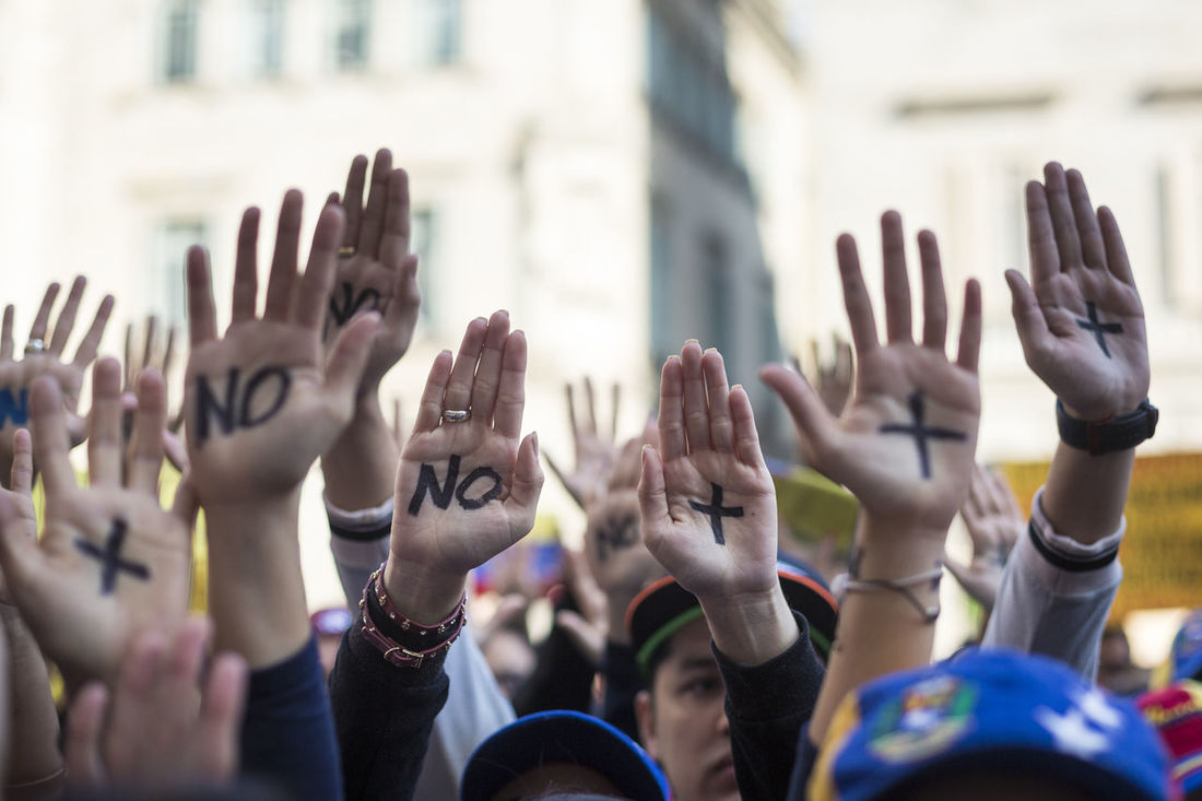 Venezuelan people prortest in Barcelona against Venezuelan Politicians on April 15, 2017 in Saint James's Square, 15 Adult City Life Close-up Documentary Documentaryphotography Freedom Group Of People Human Hand Nomas People Protest Real People SOSVenezuela Streetphotography Venezuela