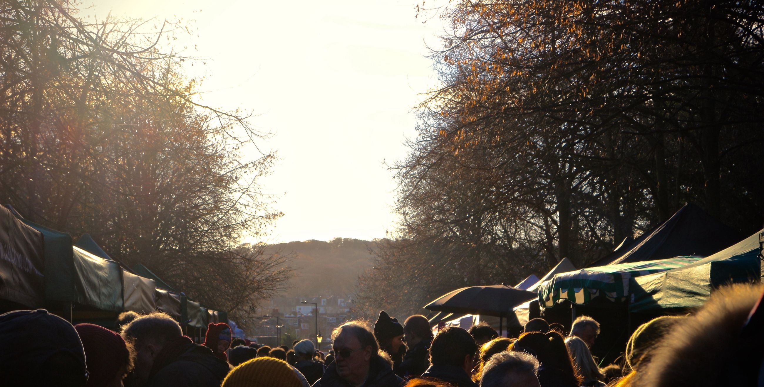 It's been a while, this is Ally Pally weekend farmers market Crowd Market Sun Lens Flare
