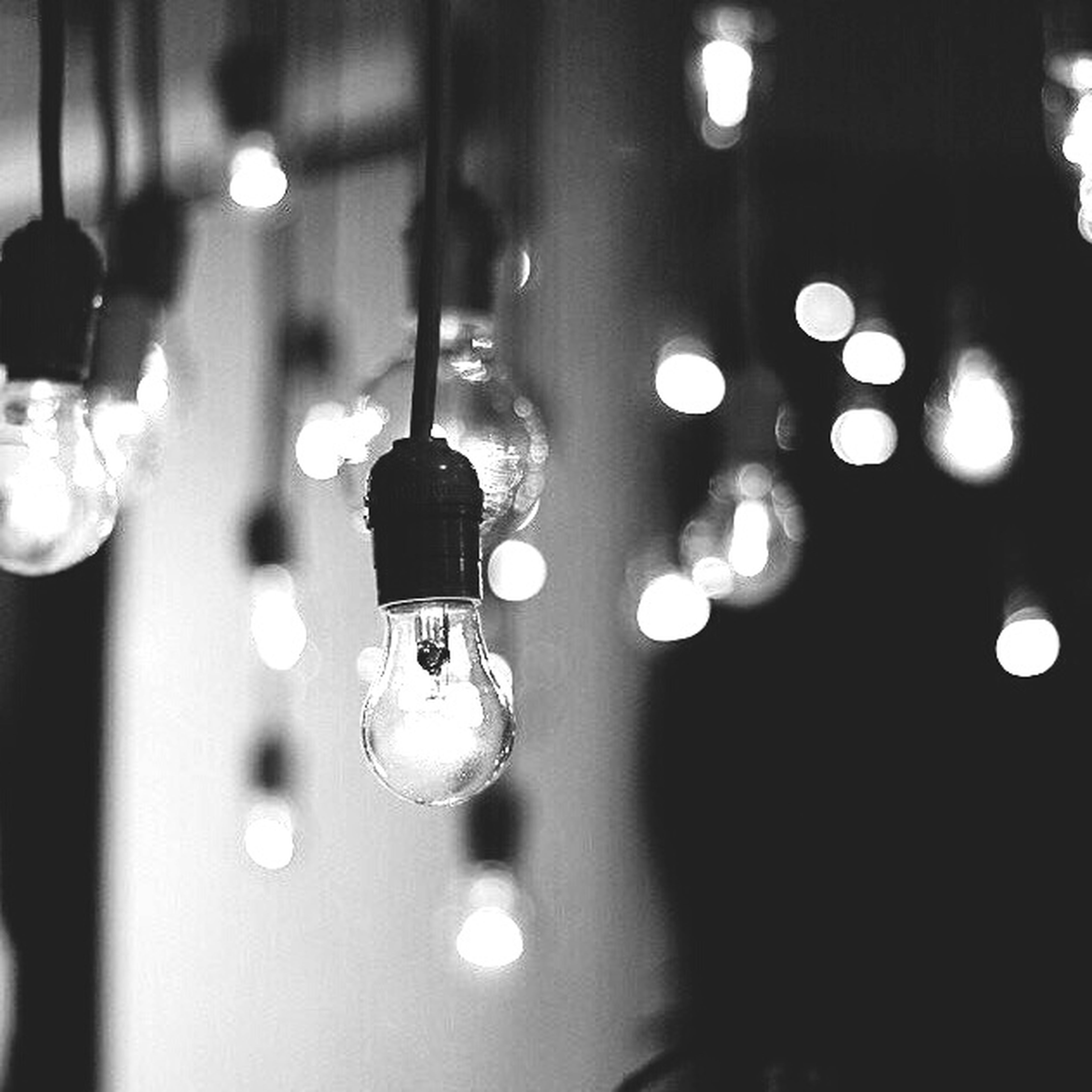 hanging, illuminated, focus on foreground, lighting equipment, indoors, no people, light bulb, low angle view, electricity, close-up, day