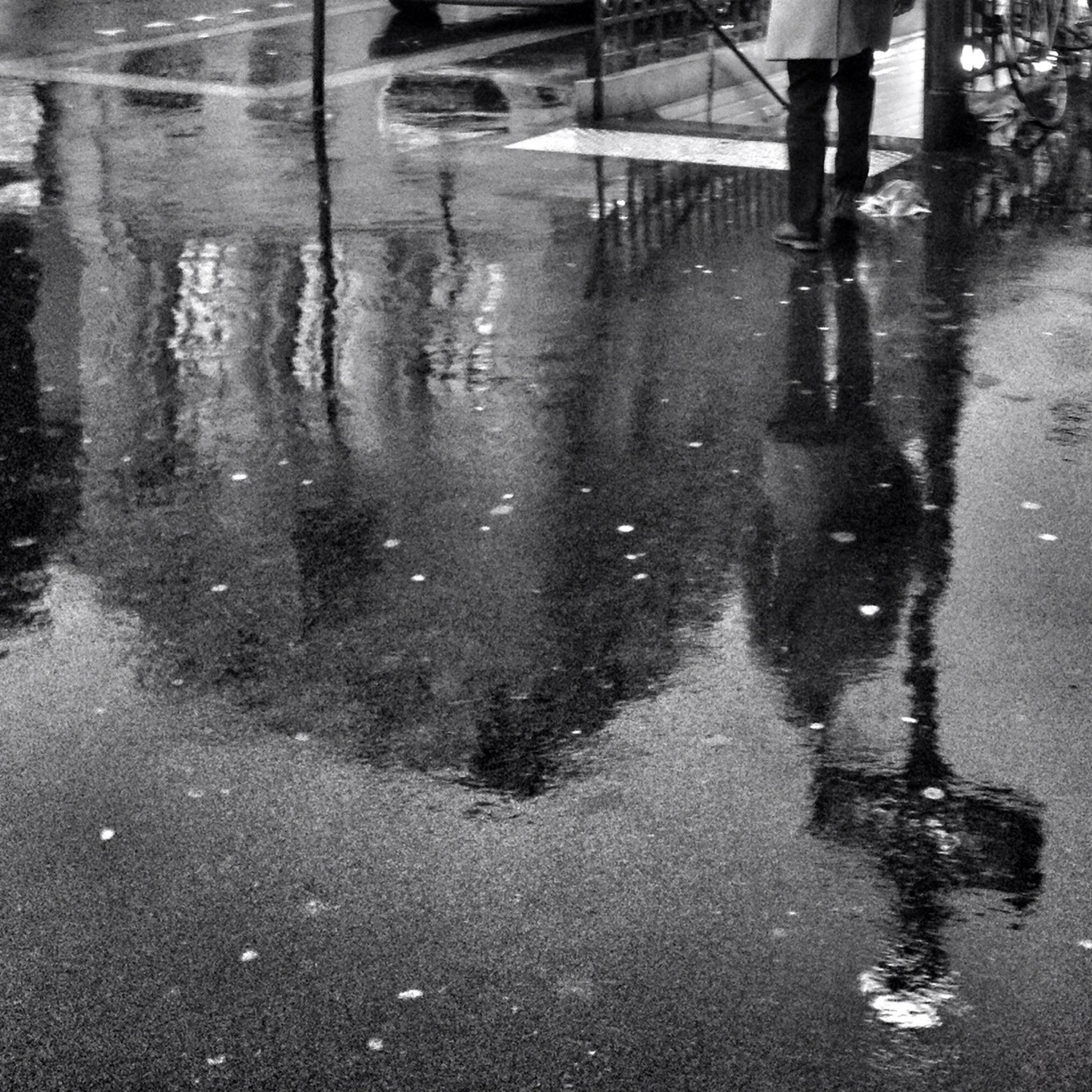 wet, water, rain, street, walking, reflection, puddle, low section, lifestyles, season, monsoon, weather, road, men, motion, leisure activity, rainy season, person