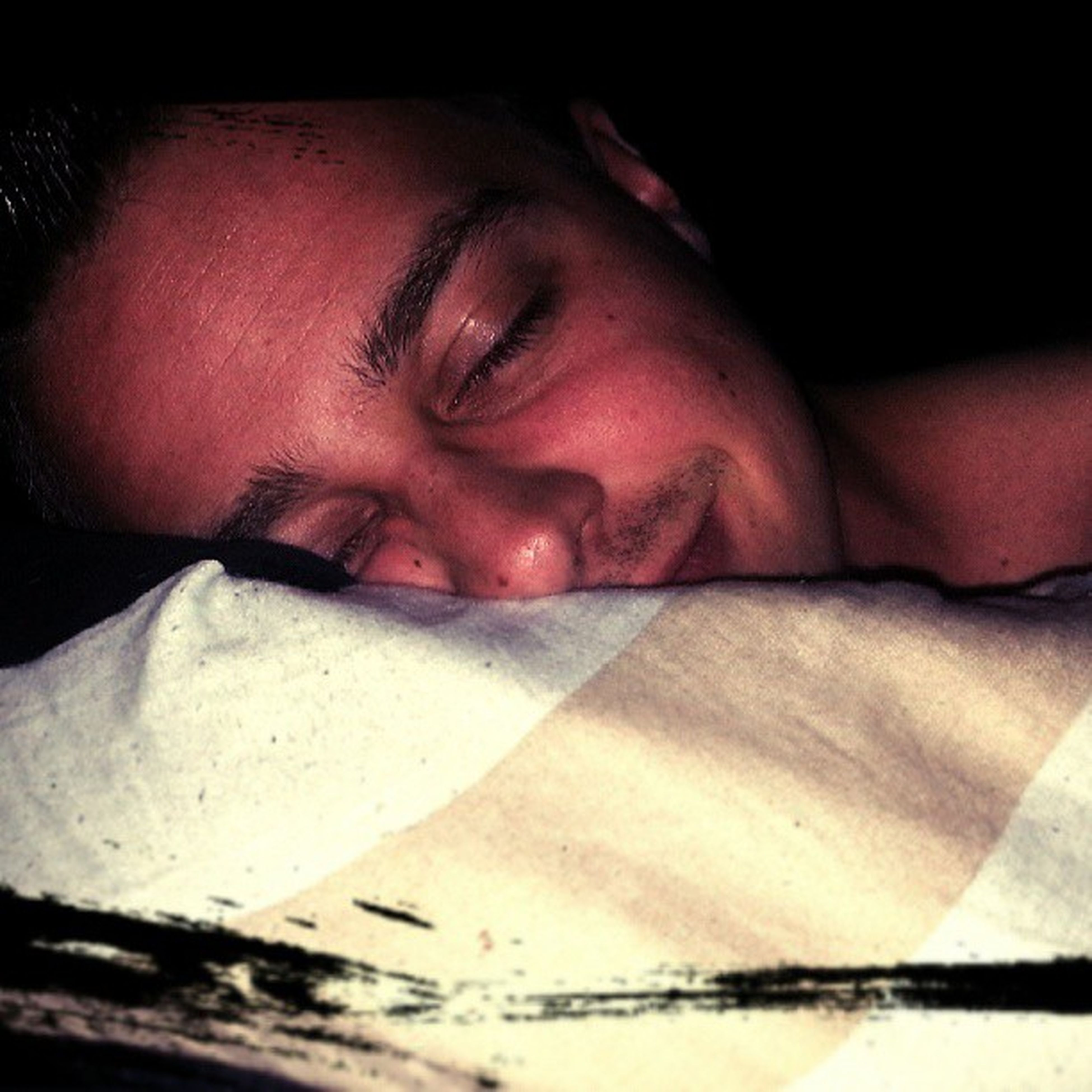 person, indoors, lifestyles, headshot, close-up, eyes closed, young adult, relaxation, front view, leisure activity, portrait, sleeping, looking at camera, young men, mid adult, bed, human face, mid adult men
