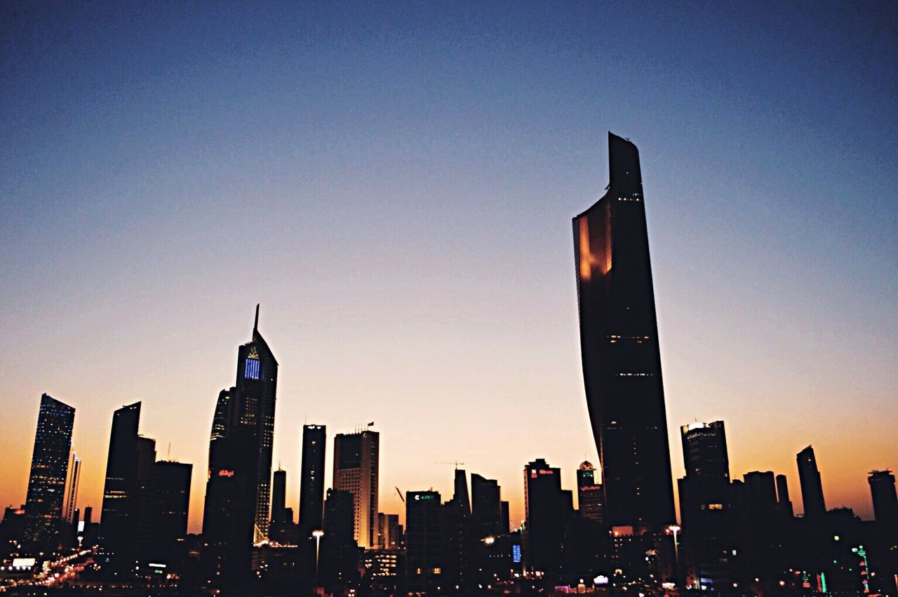 K-town City Skyscraper Urban Skyline Building Exterior Built Structure Architecture Cityscape Sunset City Life Clear Sky Outdoors Modern Sky No People Illuminated Downtown District Night Kuwait City Candid Sunlight Sunset Ktown Kuwait Kuwait City Natural Fresh On Eyeem