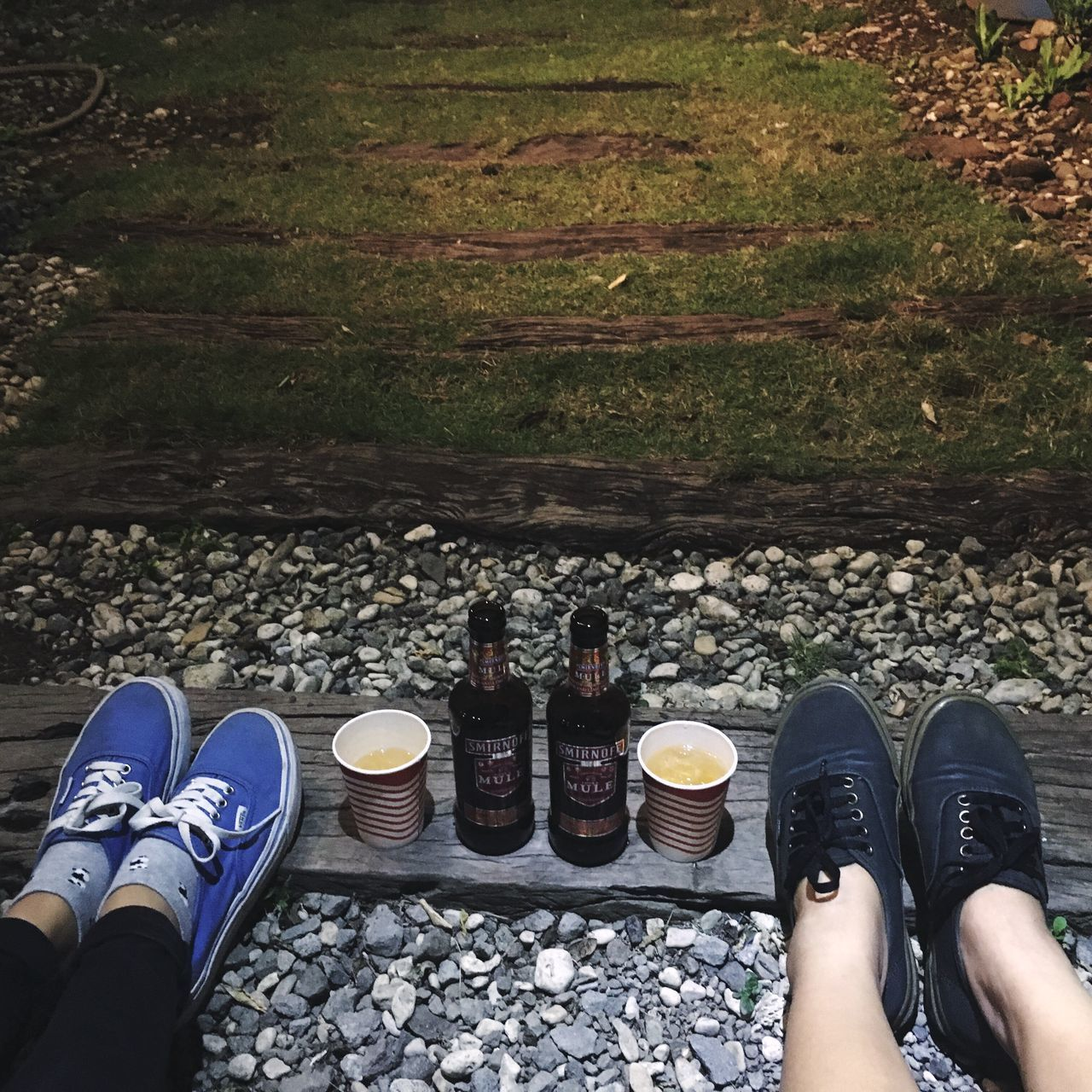 shoe, human leg, low section, personal perspective, standing, human body part, real people, human foot, high angle view, lifestyles, men, two people, friendship, day, directly above, leisure activity, canvas shoe, outdoors, togetherness, women, adult, people