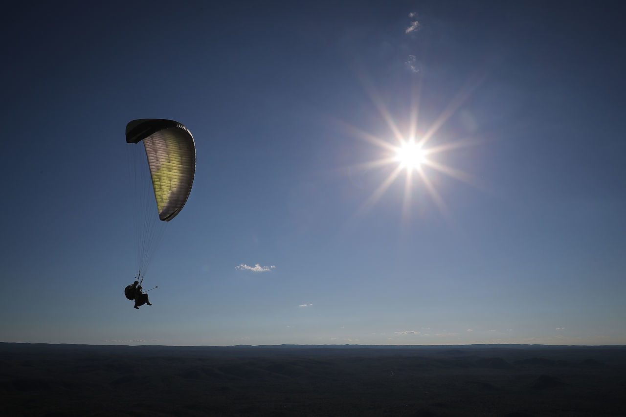 Adult Adults Only Adventure Challenge Day Extreme Sports Flying Fun Leisure Activity Nature One Person Outdoors Parachute Paragliding People Sky Sport Sun Sunlight