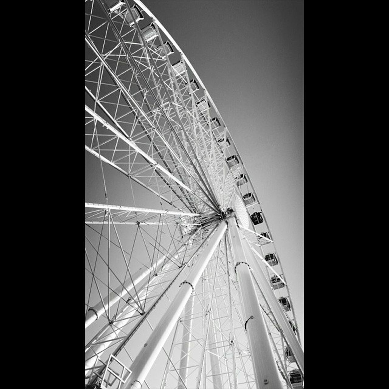 amusement park, arts culture and entertainment, ferris wheel, big wheel, low angle view, no people, amusement park ride, day, outdoors, clear sky, sky