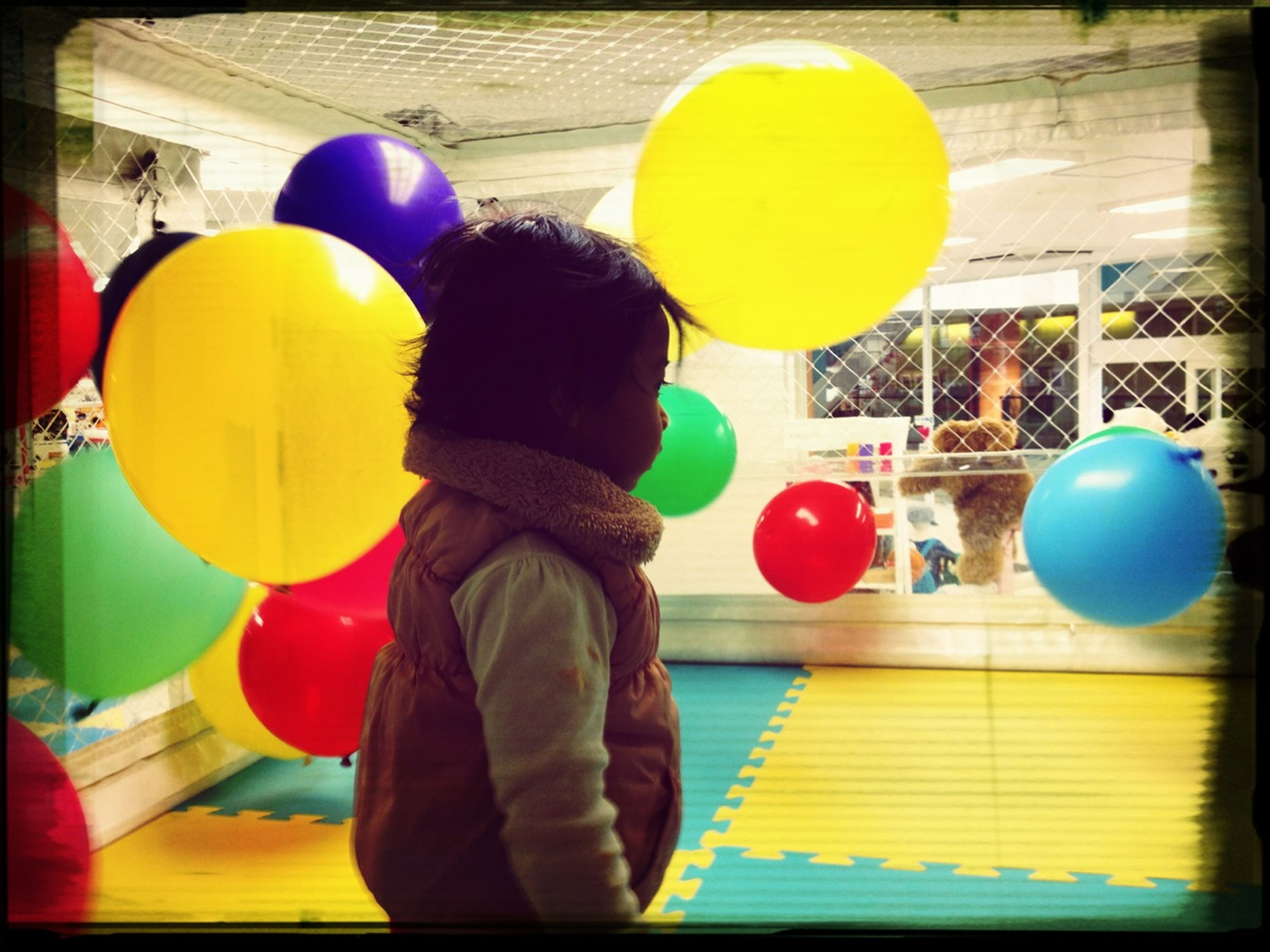 transfer print, childhood, lifestyles, leisure activity, rear view, auto post production filter, elementary age, boys, balloon, multi colored, playing, standing, yellow, girls, holding, ball, casual clothing, men