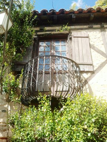 The beautiful village Rock - Gageac in France Balcony Traditional House Taking Pictures No People Eye4photography France Metal Things Capture The Moment Ivy Leaves Ivy Wall Open Window Wooden Shutters Roof Tiles Plant My View Close-up