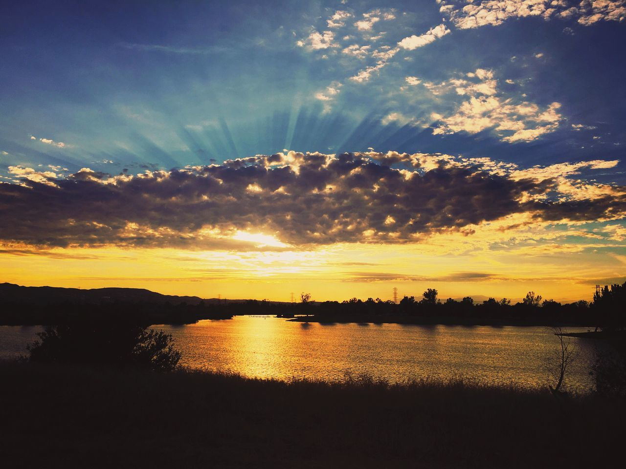 sunset, sky, silhouette, cloud - sky, scenics, water, beauty in nature, nature, river, tranquility, no people, tranquil scene, outdoors, sunlight, reflection, sun, tree, waterfront, day