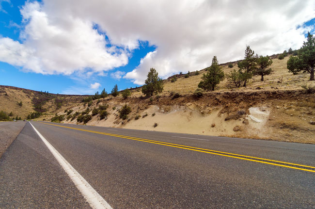Highway passing through an arid desert in Central Oregon Arid Bend Central Oregon Colorful Deschutes Deschutesriver  Desert Forest Grass Highway Landscape Nature Oregon Outdoors Park Road Rushing Tourism Travel Tree United States View Water Wild Wood