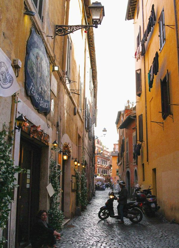 The Street Photographer - 2017 EyeEm Awards Tiny cobblestone Alley in Trastevere, Rome, Italy. Rome Italy Tourism Architecture Built Structure Building Exterior City Alley Residential Building The Way Forward Day Trastevere Roman Motorbike Street Streetphotography Summer Golden Hour Quaint  Village Narrow Live For The Story