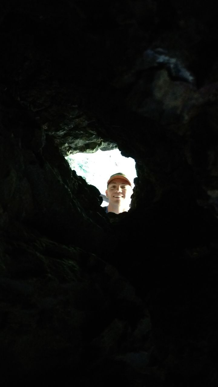 one person, real people, looking at camera, portrait, leisure activity, young adult, cave, adventure, young women, indoors, nature, day, people