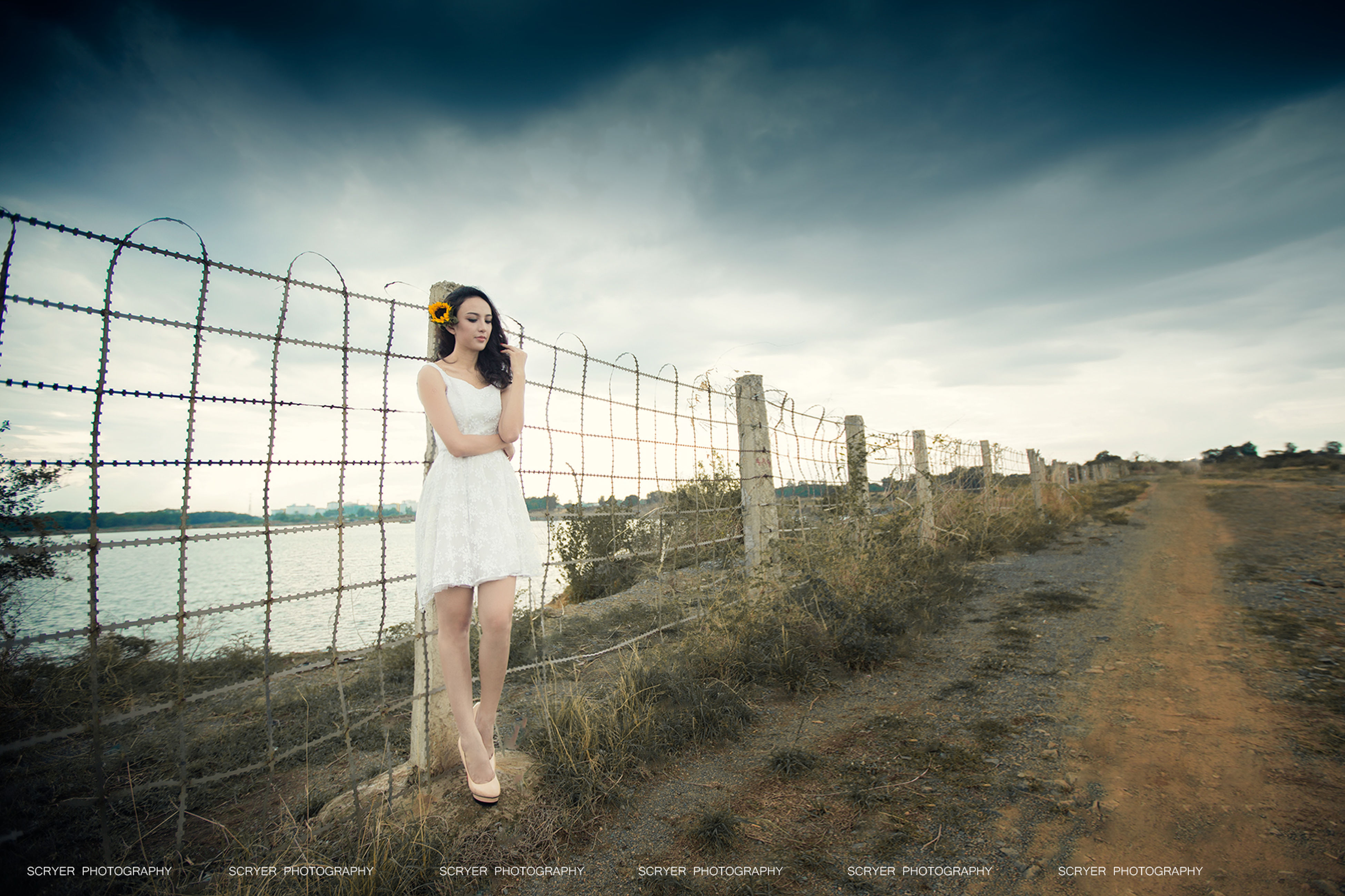 full length, sky, lifestyles, standing, casual clothing, leisure activity, childhood, fence, field, elementary age, person, boys, front view, protection, safety, cloud - sky, grass, day