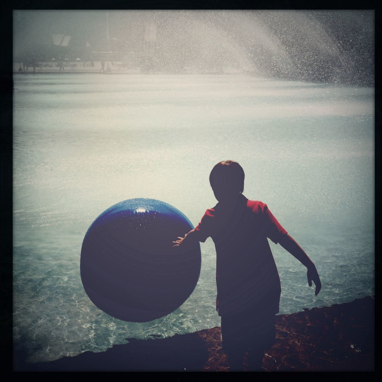 ball, standing, rear view, one person, real people, leisure activity, childhood, day, outdoors, full length, sky, nature, people